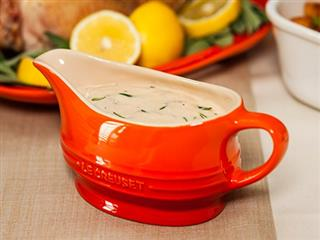 Le Creuset Gravy Boat on table