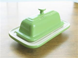 Le creuset butter dish on table