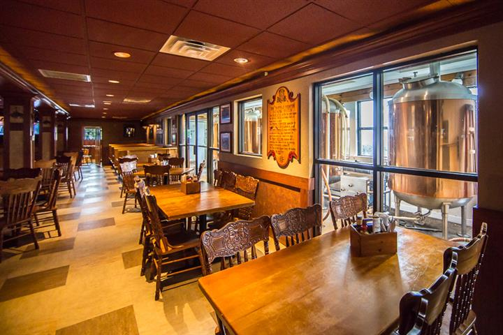 Inside the Buffalo Brew Pub with wooden tables and chairs
