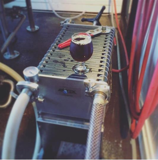 A beer glass on the fermenting equipment