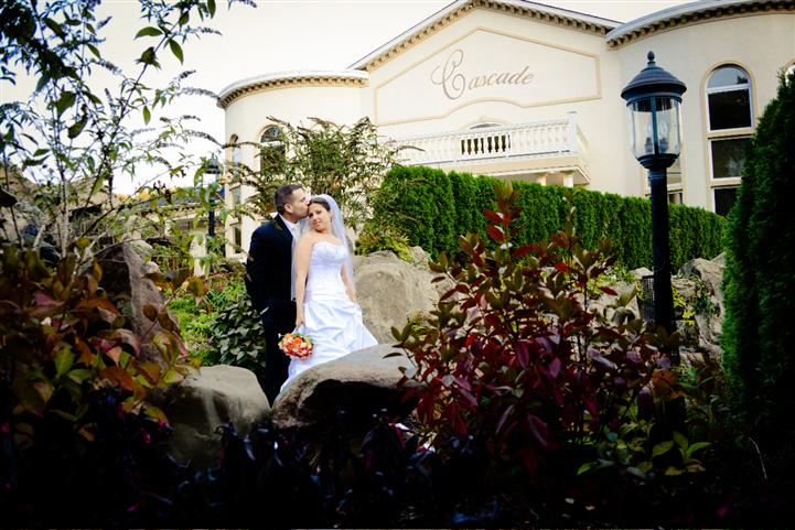Outdoor shot of a bride and groom in the garden