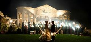 An outdoor shot of a wedding reception with the couple