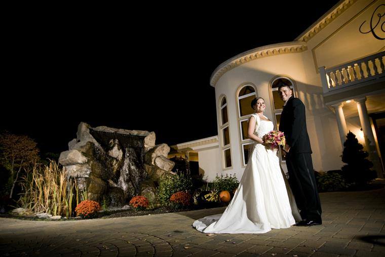 An outdoor night shot of a couple at their wedding