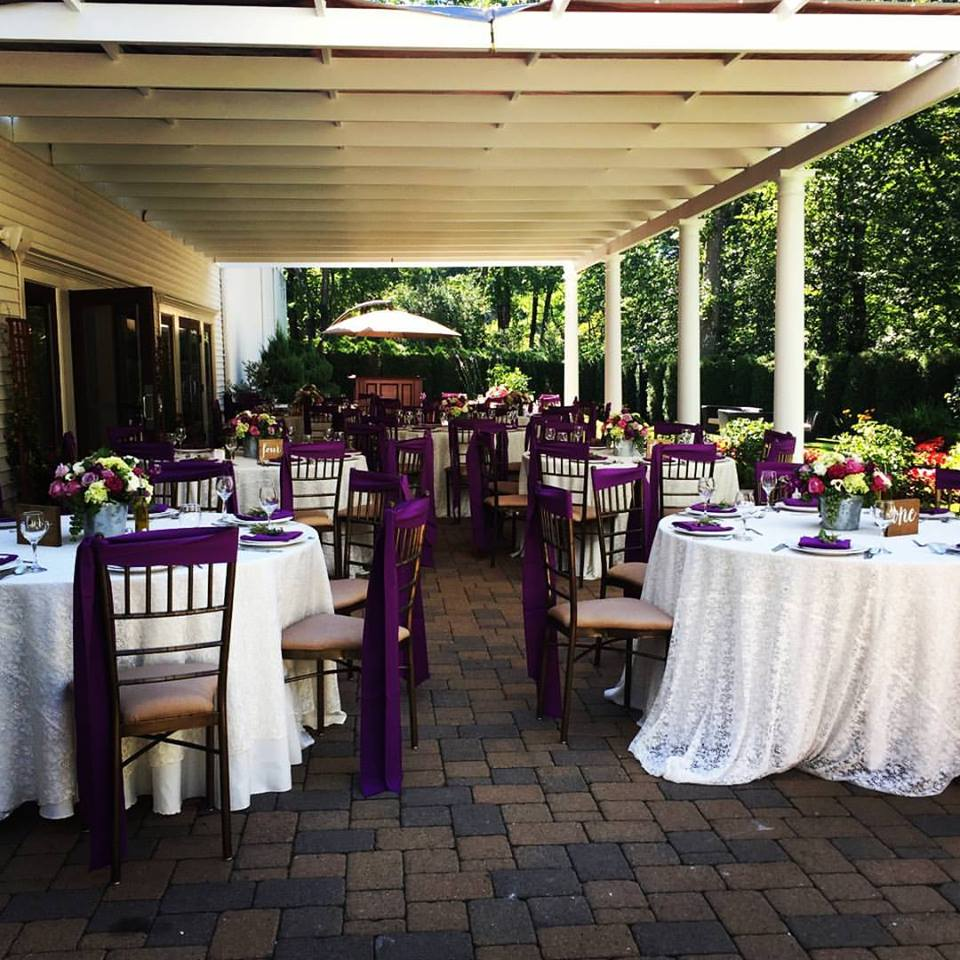 Outdoor shot of decorated round tables