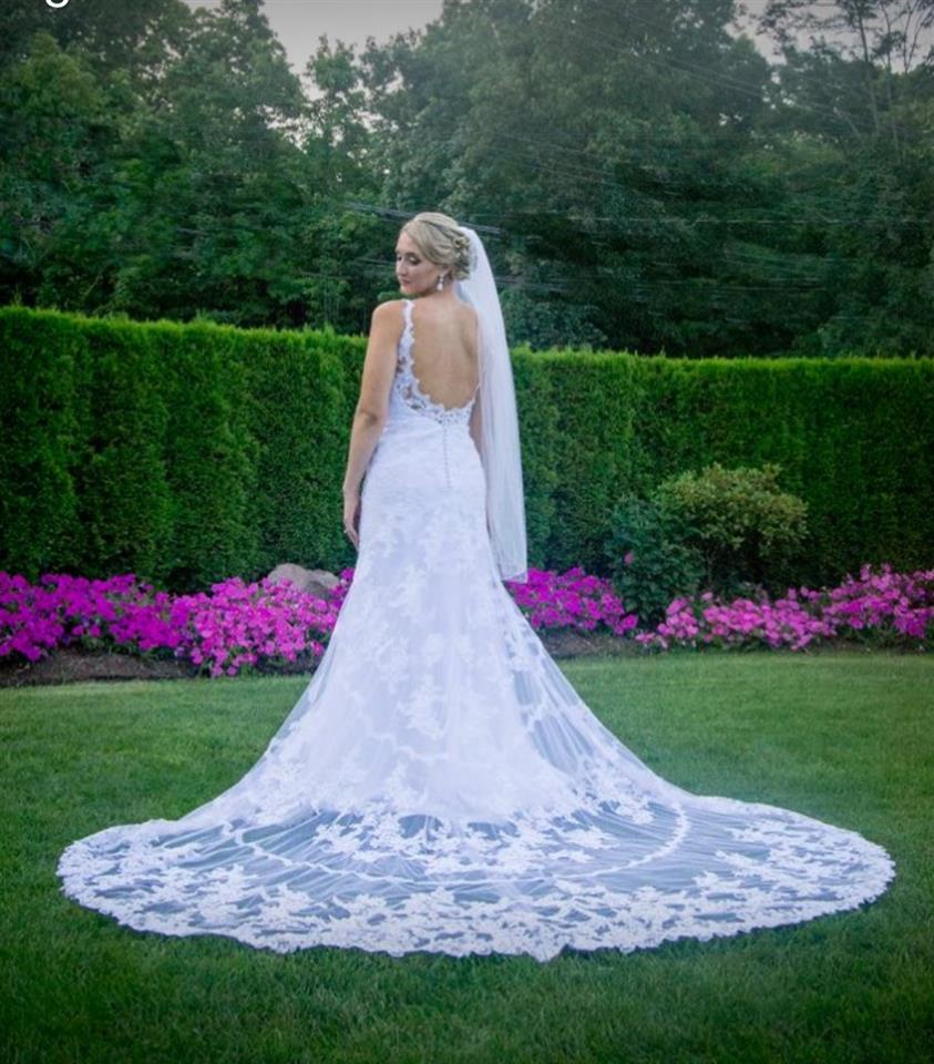 A photo of a bride in a garden