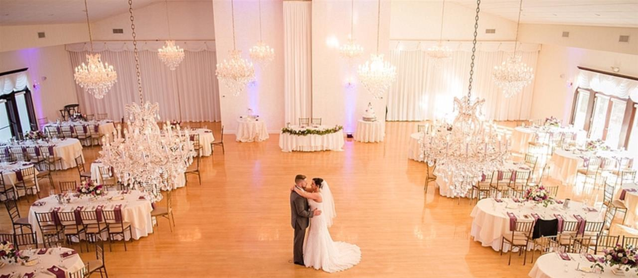 A couple dancing in an empty wedding hall