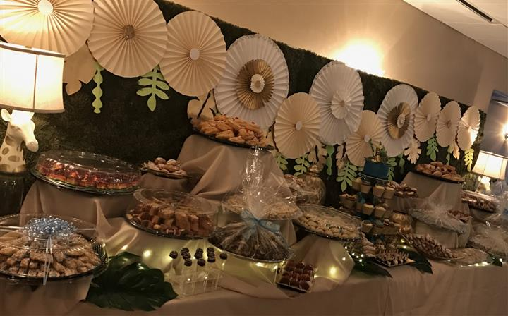 A decorated buffet with several fruit trays