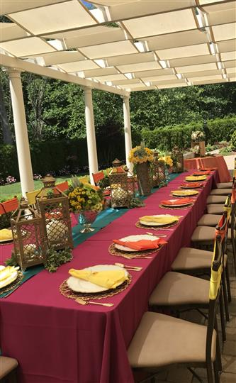 Outdoor photo of the decoration of a long table at the garden