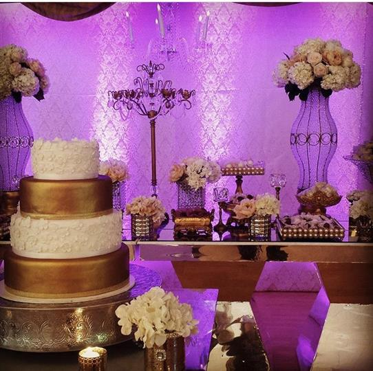 White, violet and golden wedding decoration
