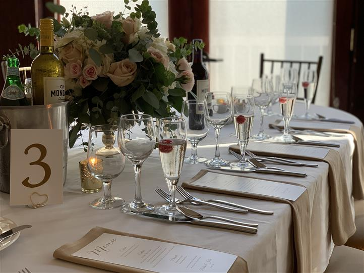 Interior decoration of the tables of a wedding reception hall