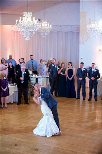 A photo of a bride and a groom while dancing in their wedding reception hall