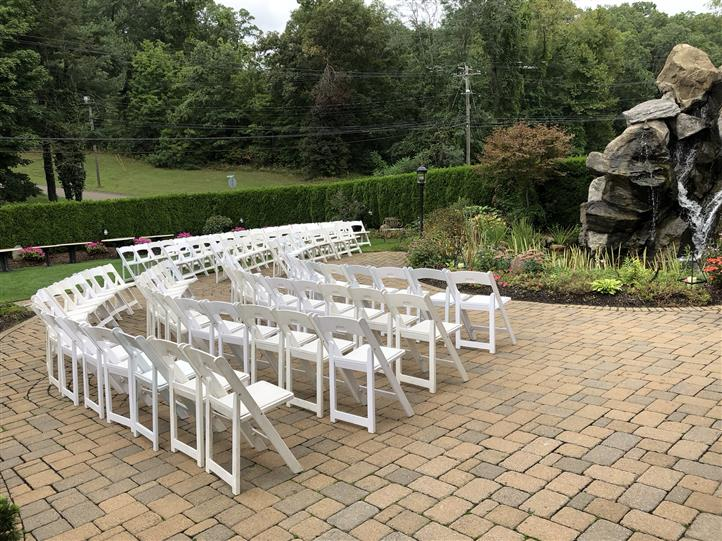 Outdoor shot of white chairs at the garden
