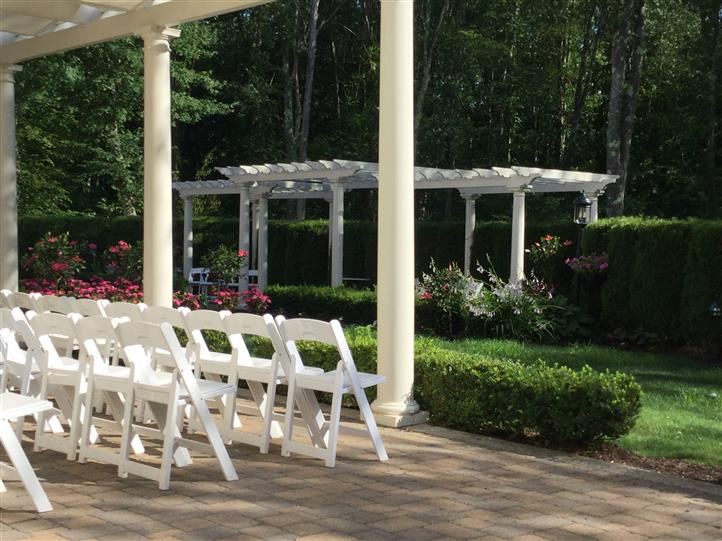 Outdoor shot of the garden with white chairs
