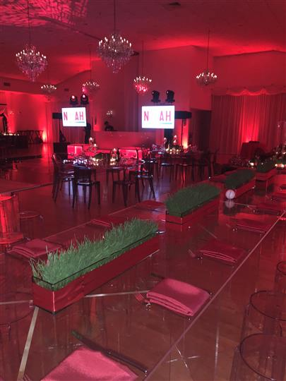 Interior shot of the red decoration of a reception hall with red lights
