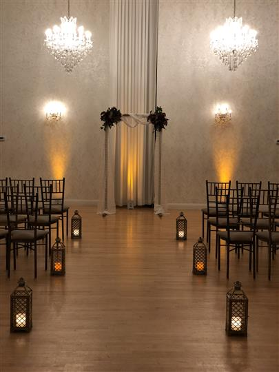 Interior shot of the white decoration of a ceremony hall with candles