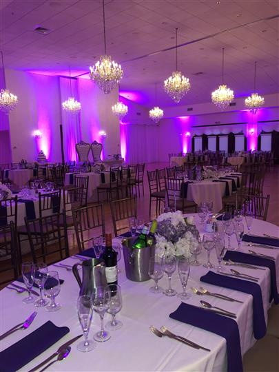 Interior shot of a reception hall with violet lights