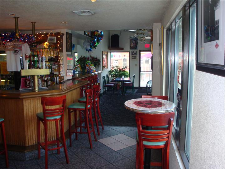 interior bar area with stools and decorative lighting