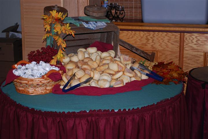 a buffet table with a pile of rolls