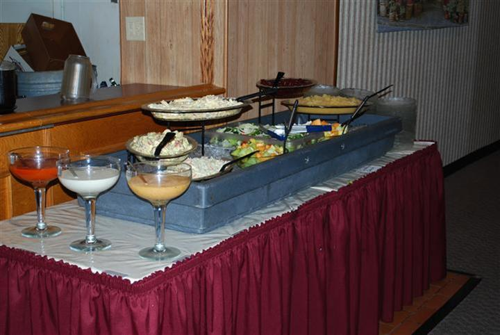 a buffet table with different side salads such as potato and lettuce