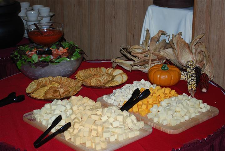 a crudite table with assorted cheeses