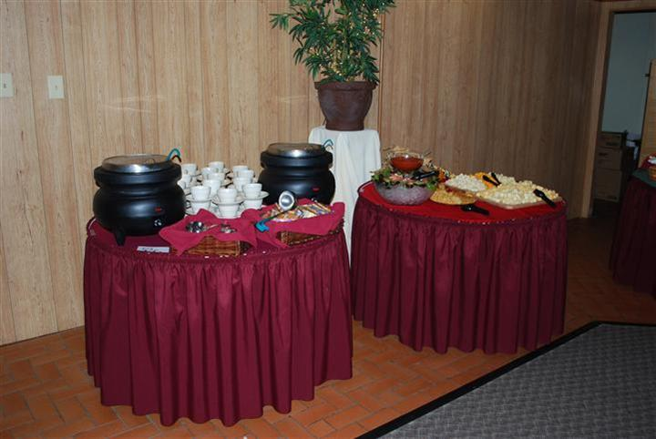 a dessert buffet tablewith soup pots, cups, salads, bread and varios toppings