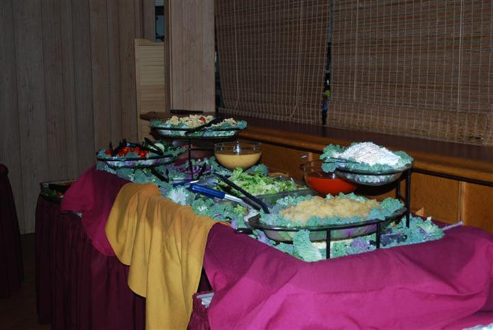 a buffet table with assorted appetizers
