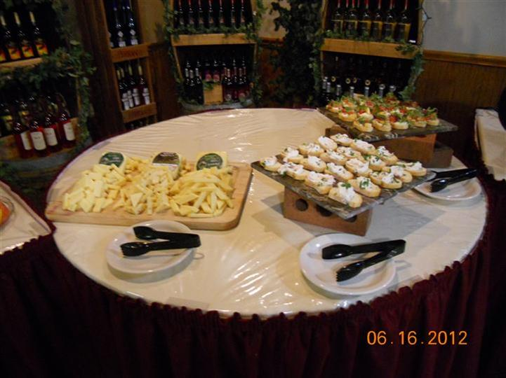 a crudite table with various cheeses and appetizers