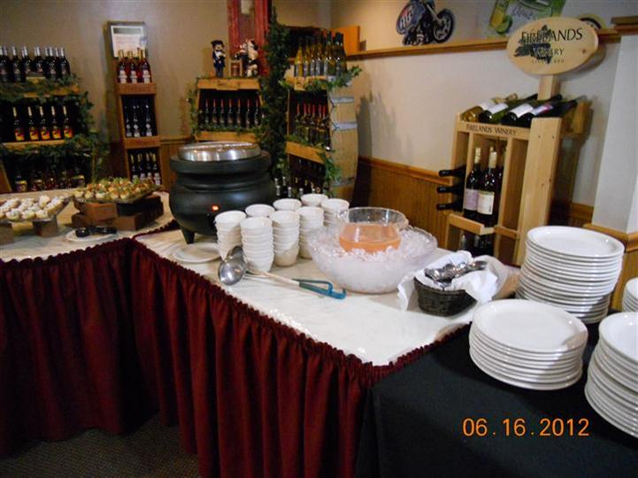 a buffet table with fondue machine