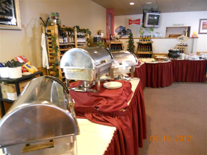 a buffet table display with various cheeses, crackers, salads, sauces, and a pumpkin decoration