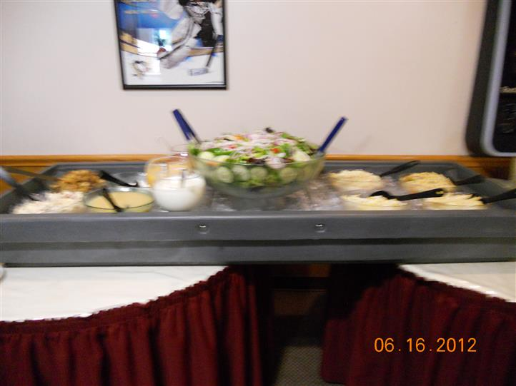 a buffet table with salad