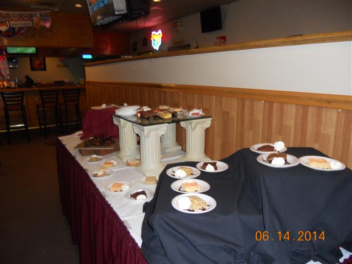 a buffet table of desserts plated