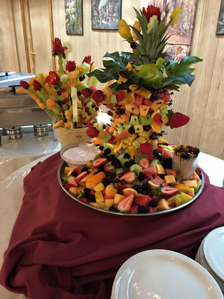 a crudite table with assorted fruit