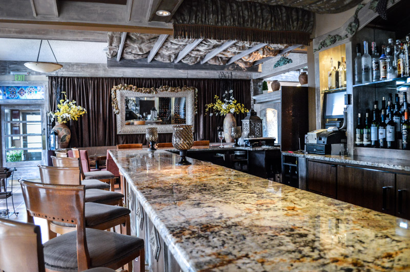 marble bar counter with empty bar stools