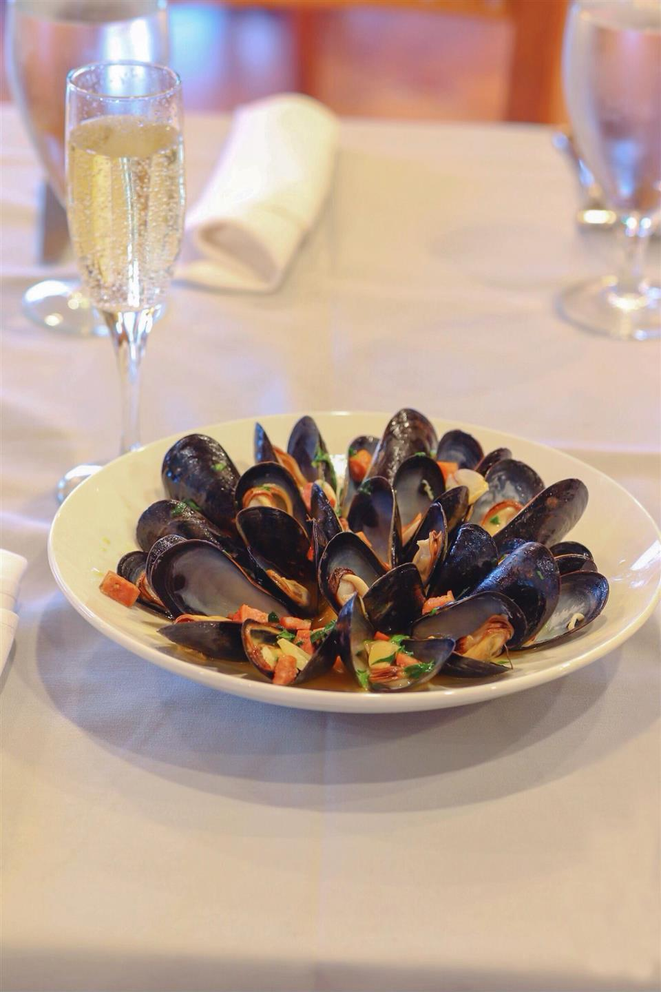 steamed mussels served with chorizo, finished with anisette and fresh herbs