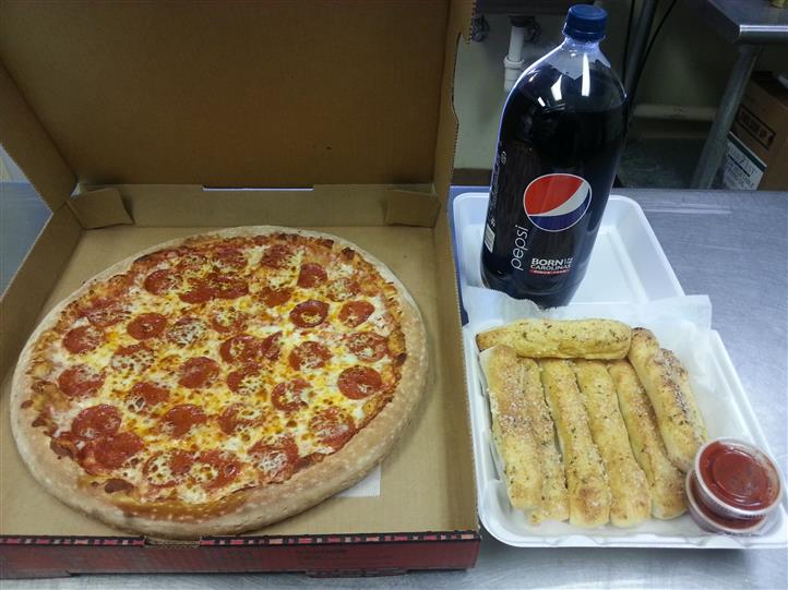 Pepperoni Pizza pie with a 2 liter pepsi and bread sticks