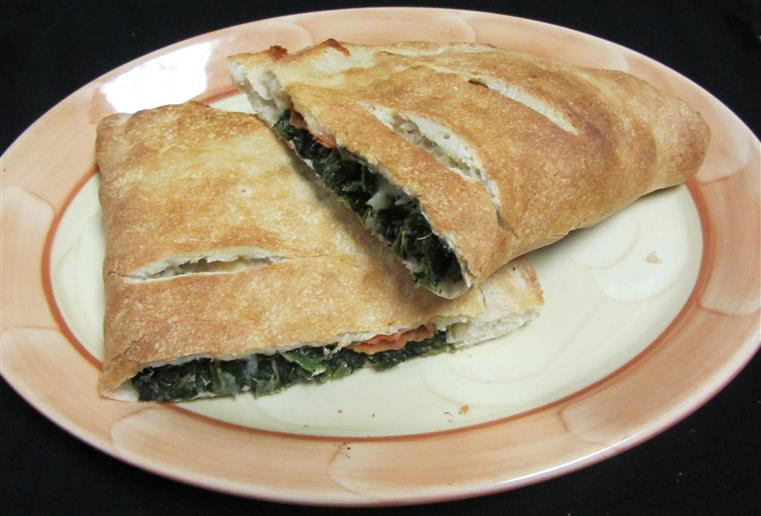 Spinach and cheese calzone on dish