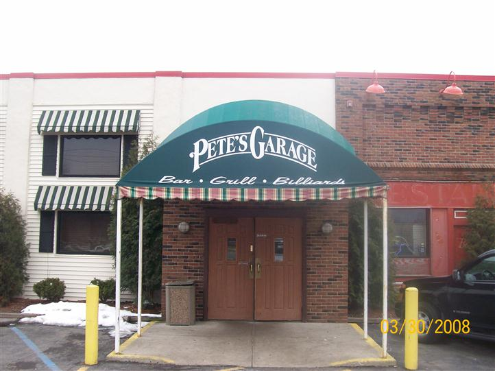 Entrance of Pete's Garage with sign