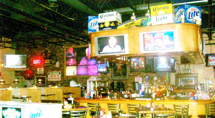 Bar area of Pete's Garage with tv's on