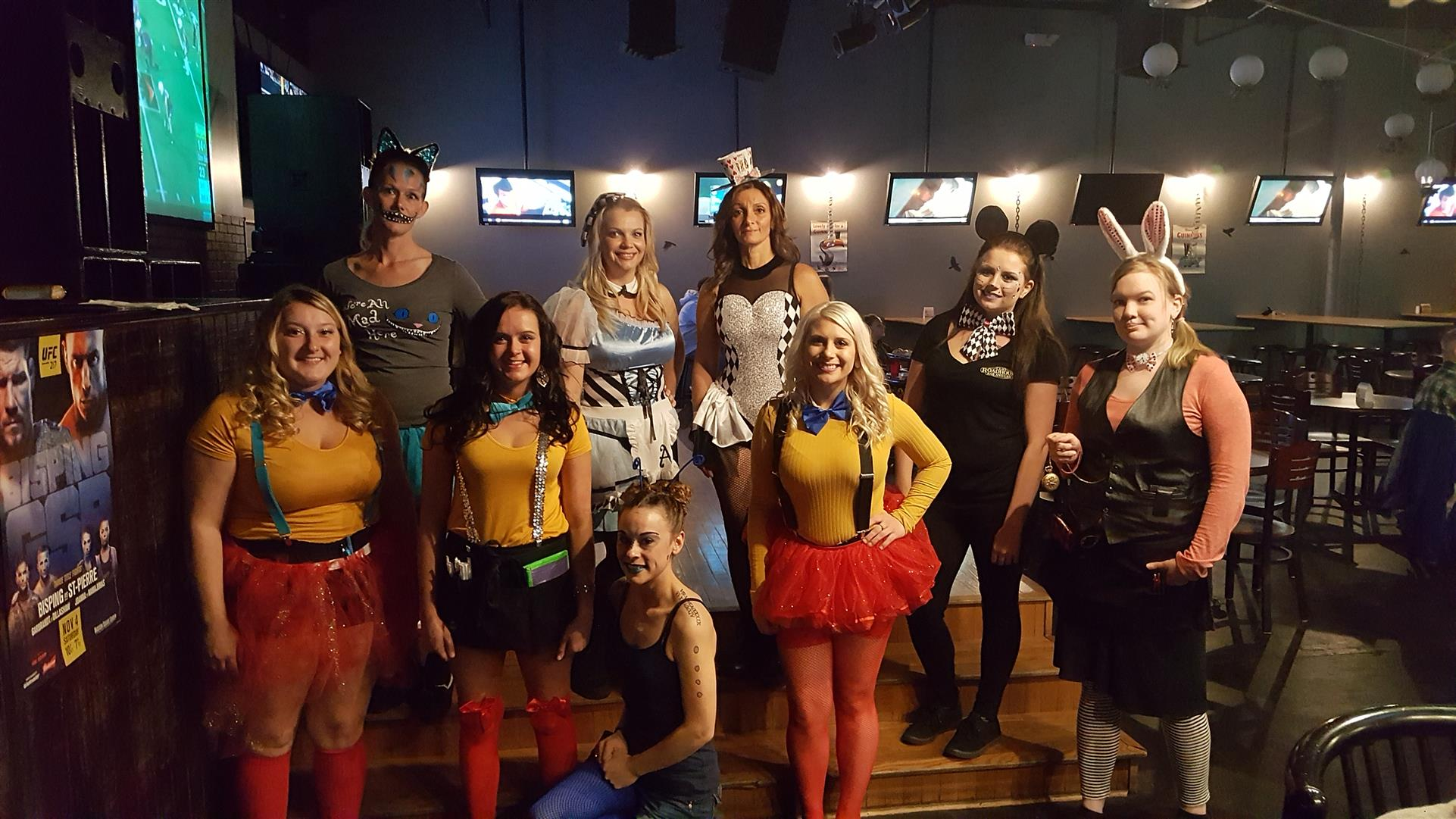 group of people in halloween costumes posing for a picture