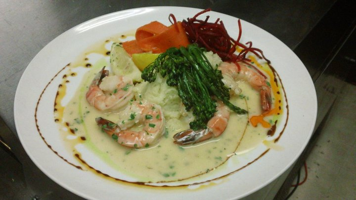 Shrimp and asparagus topped on gravy