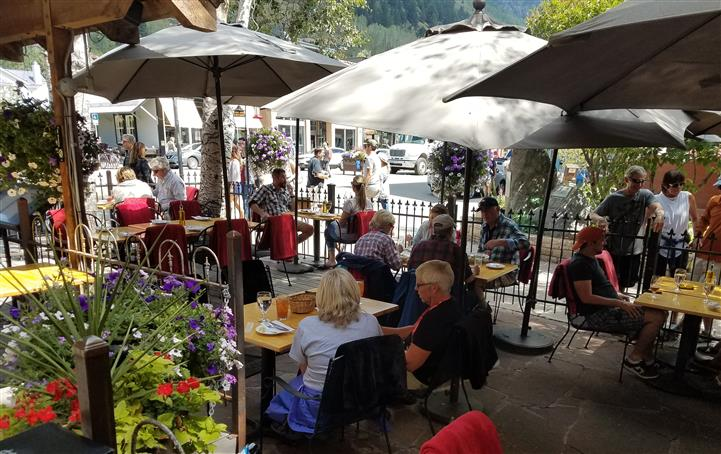 People dining at outdoor patio
