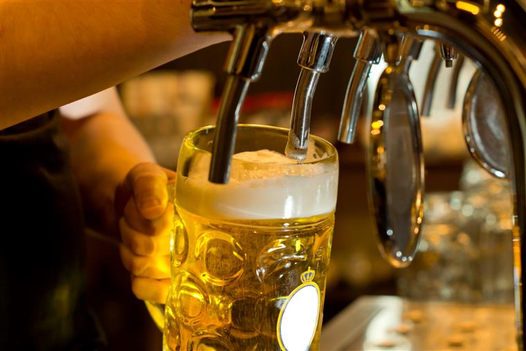 bartender pouring beer into a pint