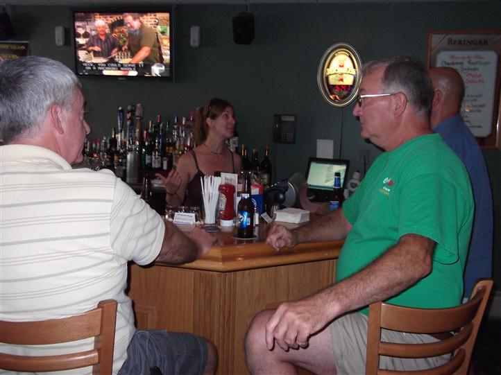 Group of people sitting at the bar