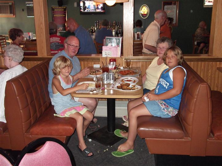 Family sitting at a dining booth in the restaurant