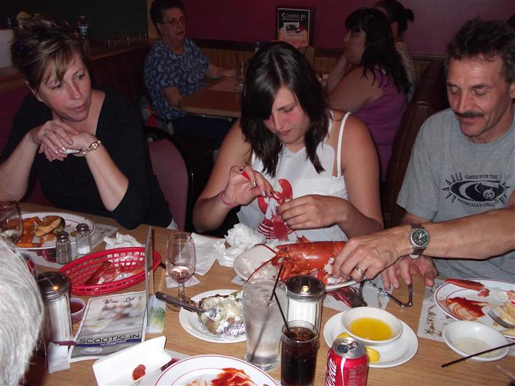 People eating lobster at the table