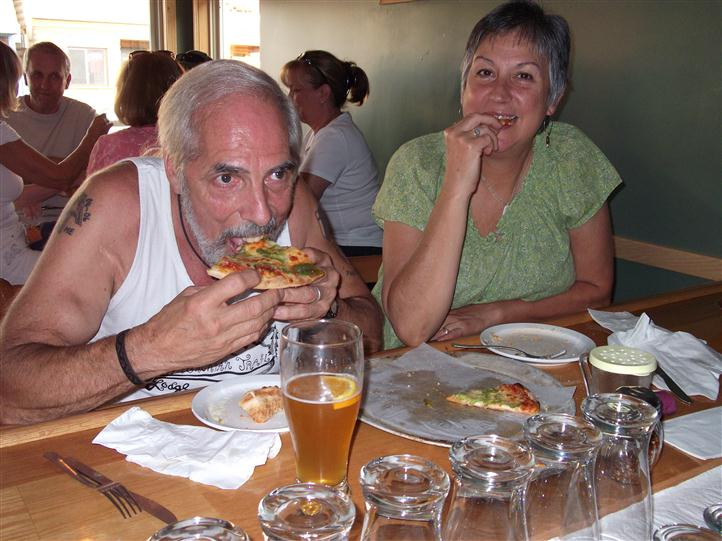 People having pizza and beer at the table