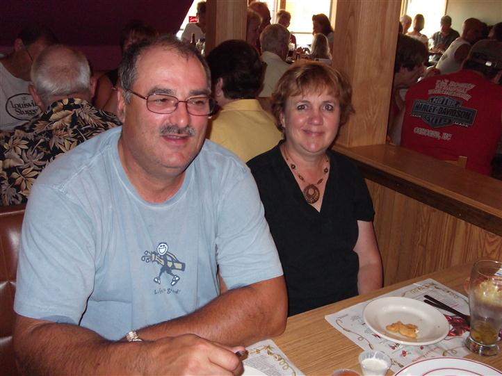 Couple posing for photo at the restaurant