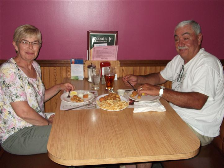 Couple having dinner at the dining booth