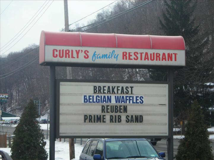 Curlys Family Restaurant with sign and promotional message board