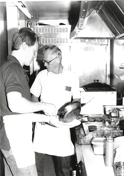 vintage photo of two men in the kitchen